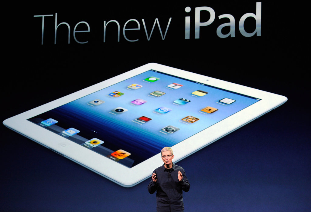 Tim Cook reveals the new iPad. At just 9.4mm thin and weighing just 1.4 pounds, the new iPad is slightly heavier than its predecessor and comes with improved features over the iPad 2.