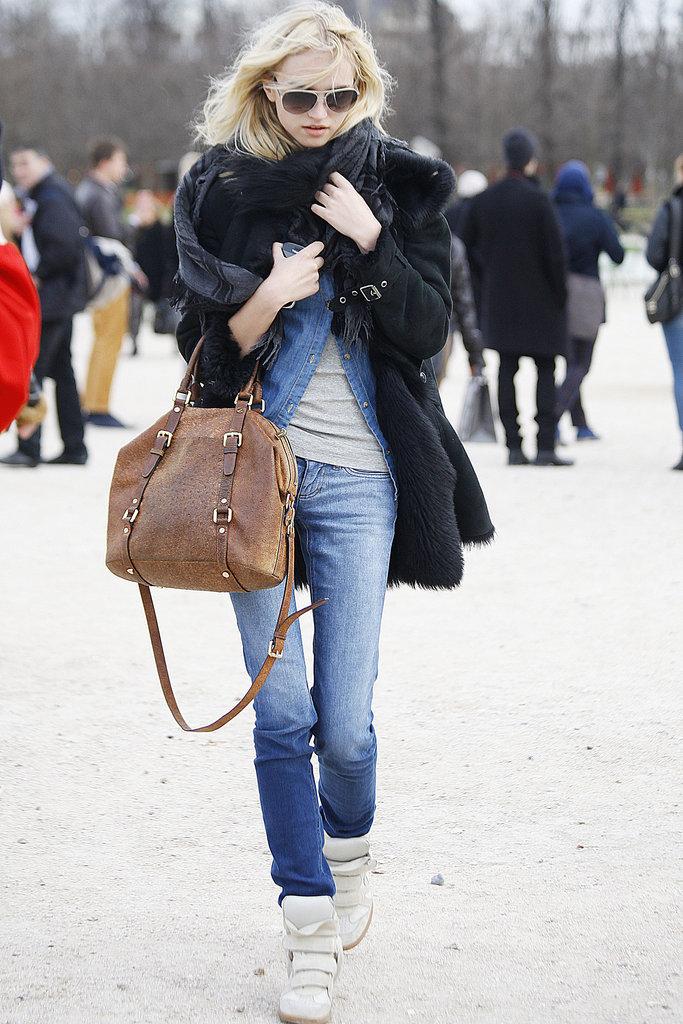 Isabel Marant kicks amp up basic denim — as does a furry black coat.