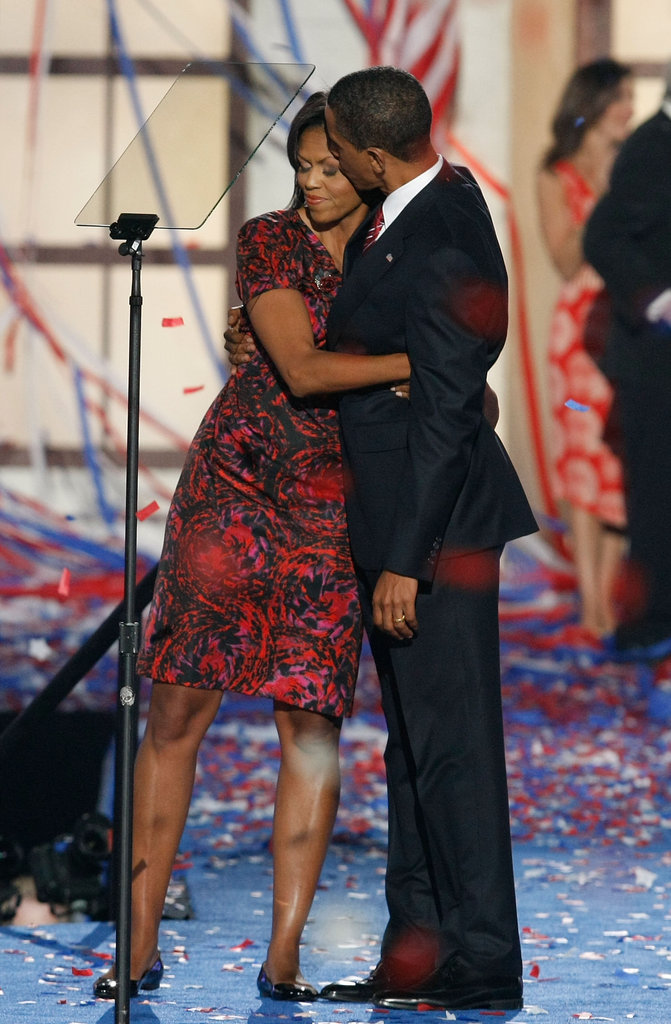 Michelle gives Barack a sweet hug at the Democratic National Convention.