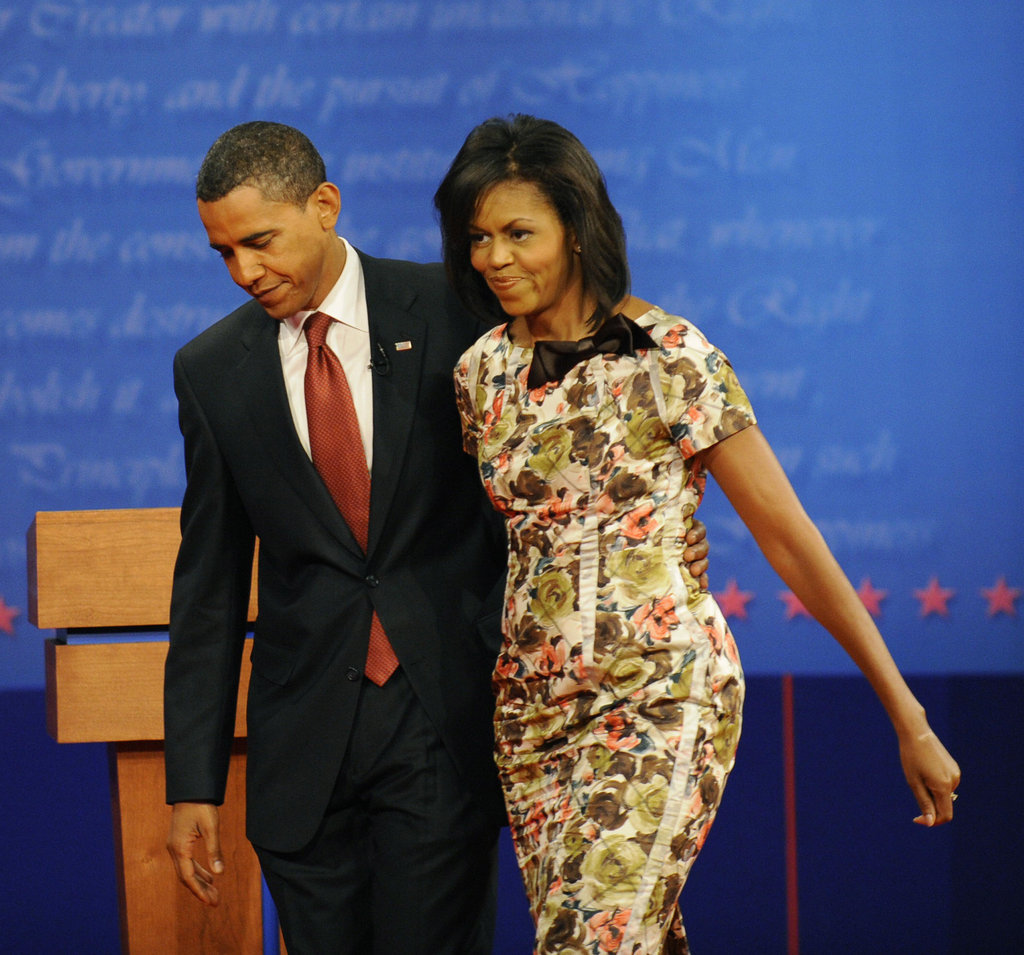 Michelle and Barack leave the stage together at a debate in Mississippi.