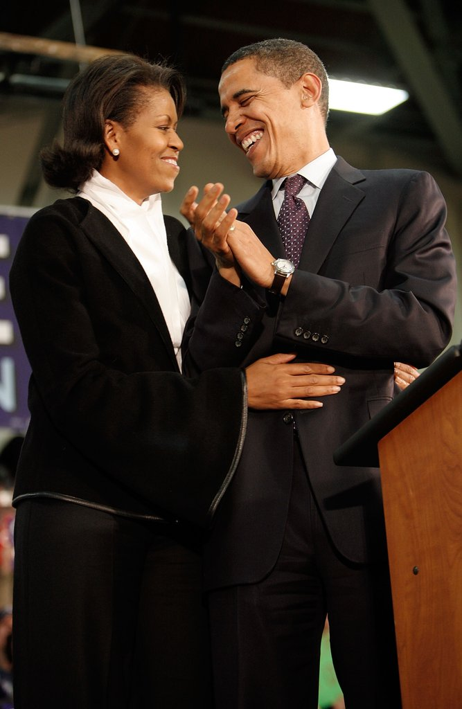 Michelle shows some affection during a rally in New Hampshire.