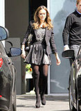 Jessica Alba in a black leather skirt.