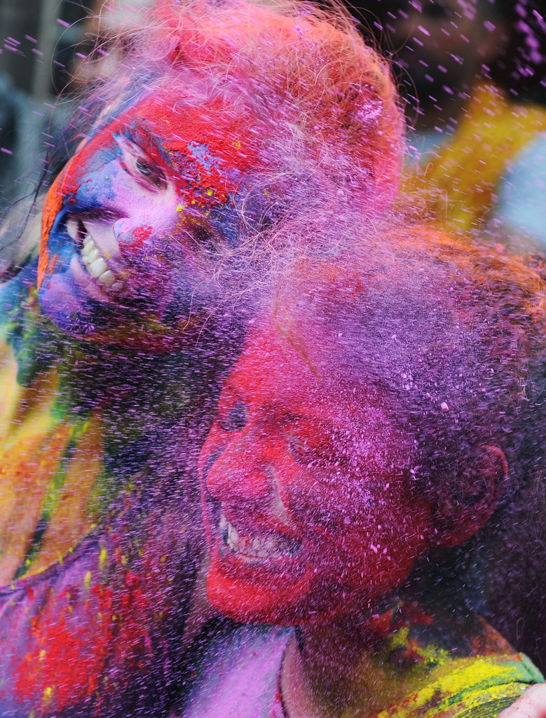 Young People Enjoy a Splash of Color During Holi Celebrations