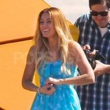 Lauren Conrad had her hair and wardrobe touched up before chasing the pups.