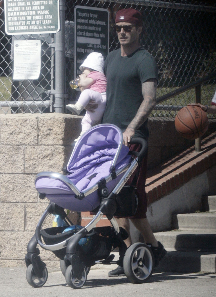 David Beckham carried daughter Harper Beckham.