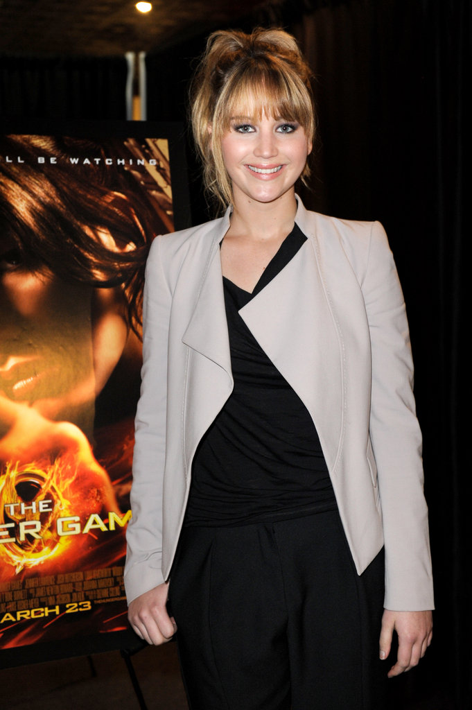 Jennifer Lawrence pulled back her blond hair for the day event.