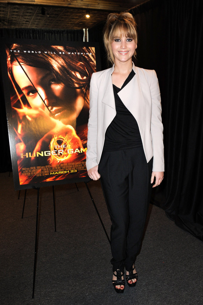 Jennifer Lawrence dressed in black and a neutral jacket.