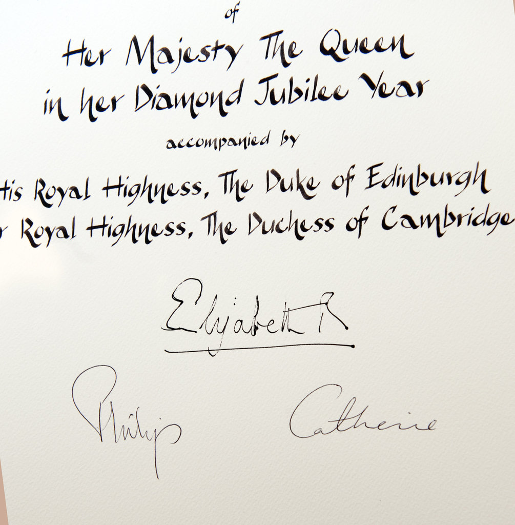 A certificate featured the signatures of Queen Elizabeth II, Prince Philip, Duke of Edinburgh, and Catherine, Duchess of Cambridge, commemorating their visit to Leicester Cathedral on the first day of her Diamond Jubilee tour.