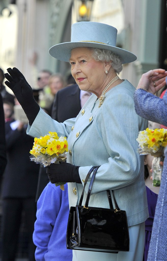 The queen waved to well wishers.