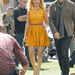 For her stint on Extra, Nicole sported a marigold Thakoon dress with a Navajo-inspired belt and House of Harlow platforms. 