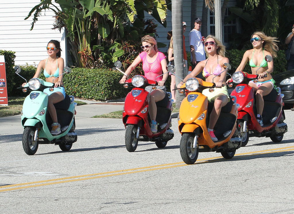 The Spring Breakers costars took over the streets on their colorful bikes.