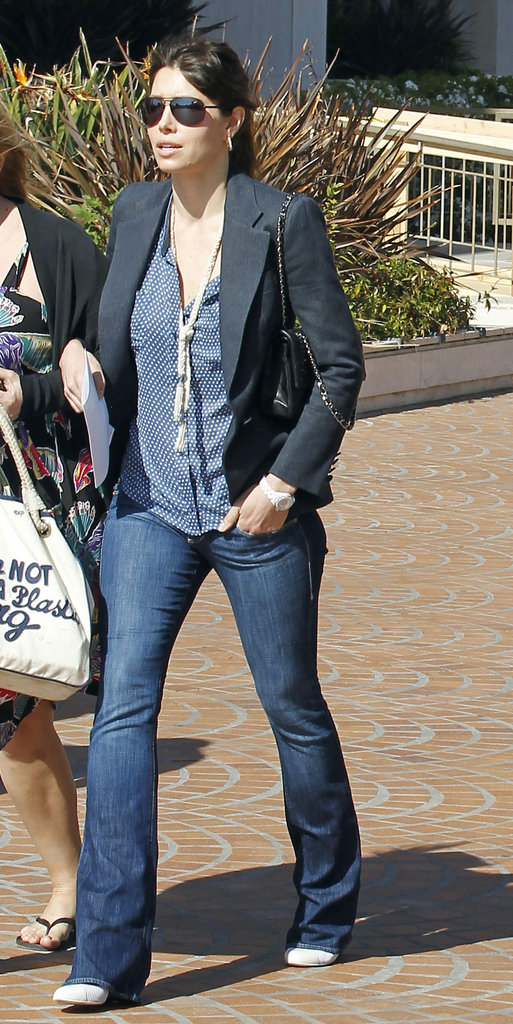 Jessica Biel sported a pair of slim fit and flared denim topped with a ladylike blouse.