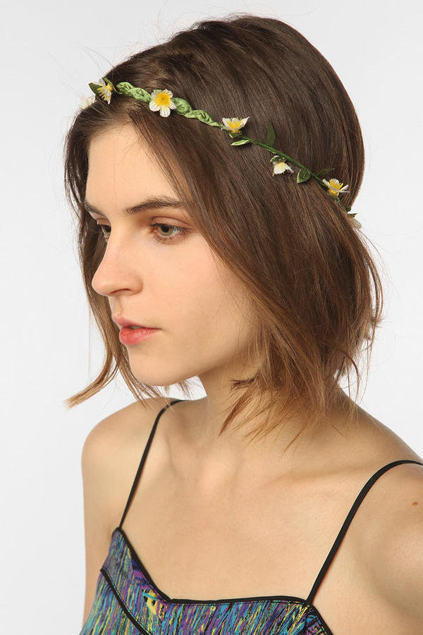 Spring is the perfect time to be one with nature; we're starting with this floral headband.  Urban Outfitters Floral Crown Headwrap ($16)