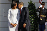 Barack Obama leans in close to wife Michelle.