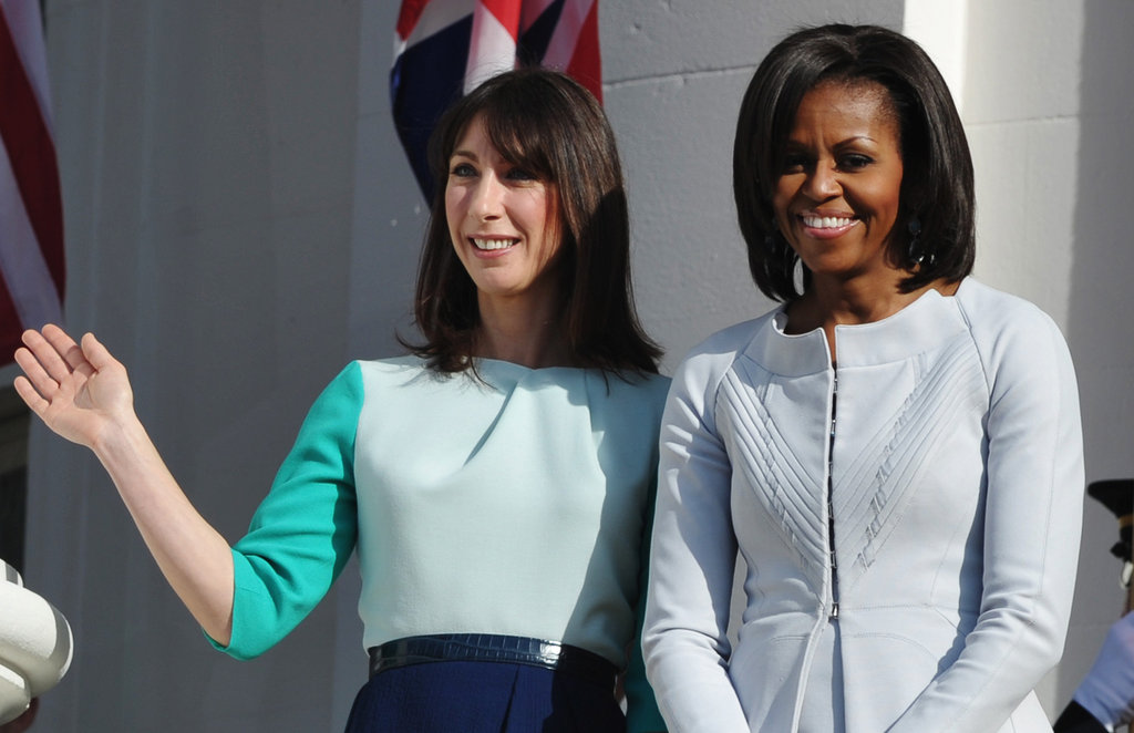Samantha waves beside Michelle.