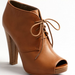 We love the cool, dark camel hue paired with the lace-up detail.
