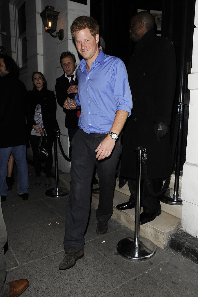 Prince Harry in a blue shirt.
