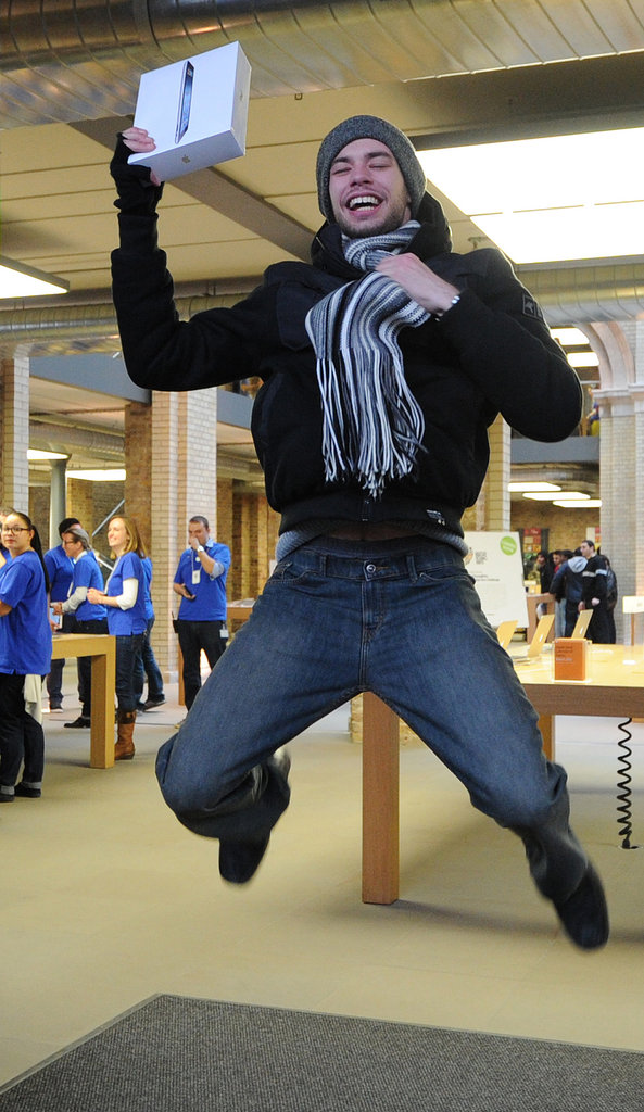A Londoner jumps for joy as he leaves the Apple Store with his new iPad.