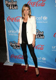 Heidi Klum showed off her white blazer against skinny leather bottoms.