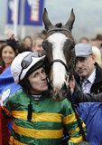 Jockey Tony McCoy has a smooch for his mount Synchronised after winning the Cheltenham Gold Cup.