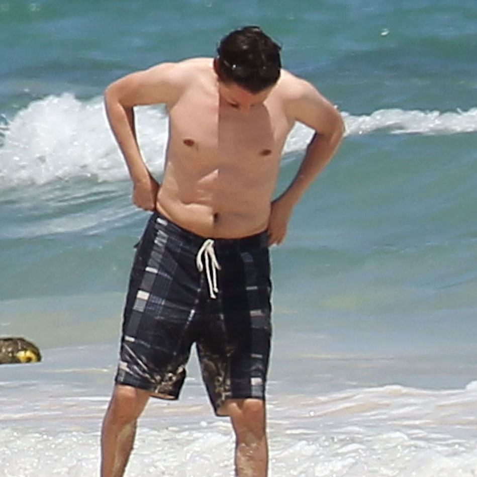 Matthew Bellamy went shirtless on the beach.