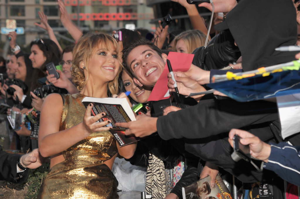 Jennifer Lawrence snapped pics and signed autographs during the world premiere in LA last week.