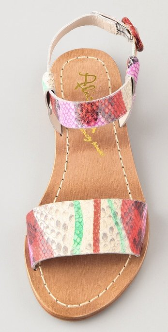 These adorable snakeskin-embossed leather sandals feature an abstract maroon, crimson, and mint green design and are more visible if worn with neutrals.  Alice + Olivia Bella Print Flat Sandals in Coral Multi ($148)