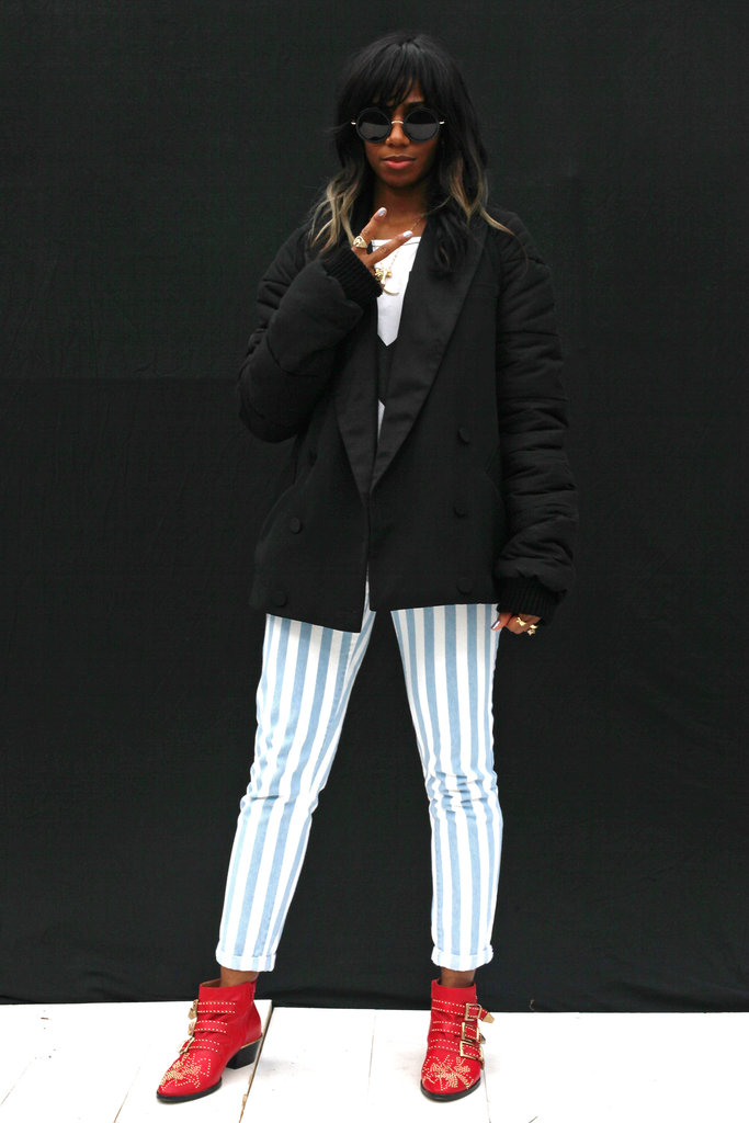 Santigold pairs an oversized tuxedo blazer and bold red booties with candy-striped jeans.