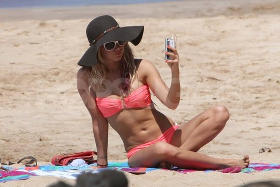 Ashley Tisdale Hits the Beach in a Hot Pink Bikini