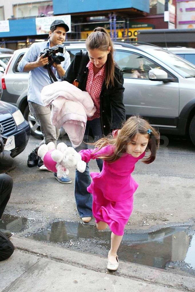 Suri Cruise Hops Along the Streets of NYC With Mom Katie Holmes
