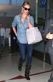 Charlize Theron perfected the denim on denim vibe for effortless travel style.
