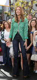 Jessica Alba topped high-waisted flares with a Spring-bright blazer.