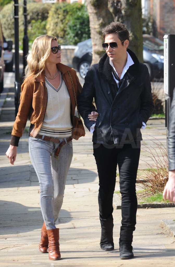 Kate Moss and Jamie Hince carried on a conversation.