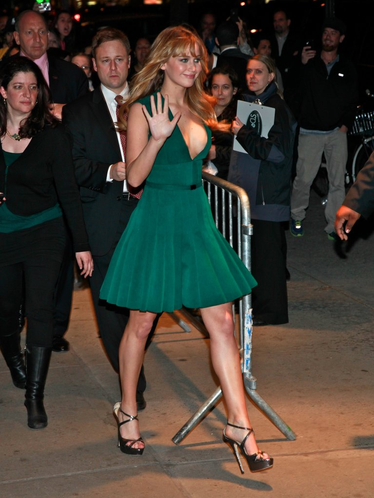 There's no doubt about it — Jennifer Lawrence can wear color beautifully. We especially love the deep emerald hue of this dress (and how softly the pleats moved).