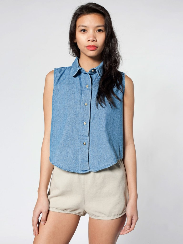 Style up this sleeveless denim shirt with a bolero necklace for a snap-worthy western look.  American Apparel Denim Sleeveless Top ($45)