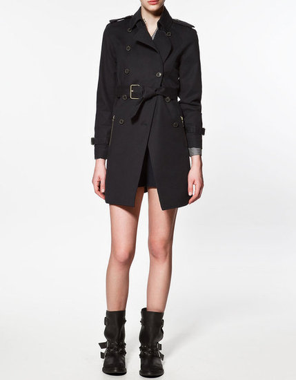We love the tougher feel of this trench in a deep navy hue, and we might just wear it the same way: with our biker boots on a rainy Spring day. Zara Trench Coat With Double Buttons ($100)
