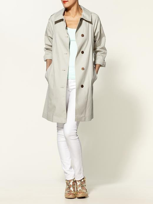 We love the pared down, minimalist take on this version that would complement just about any outfit.  Marc by Marc Jacobs Mia Trench Coat ($498)