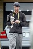 Matthew McConaughey carried a newspaper in Austin.