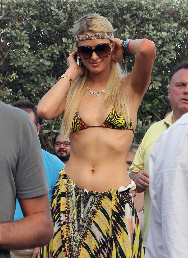 Paris Hilton chatted on the phone while hanging out by the pool.