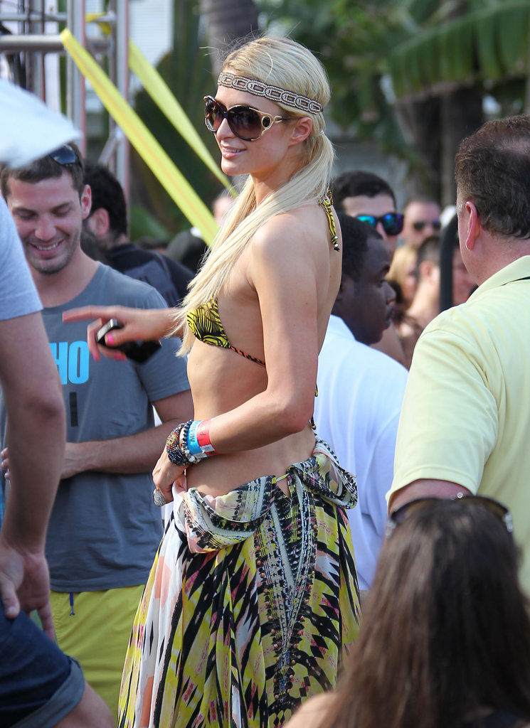 Paris Hilton wore a folded-down dress with her yellow, printed bikini in Miami.