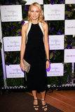 Naomi Watts opted for a sleek Stella McCartney sheath, then added luxe with the designer's faux python clutch.