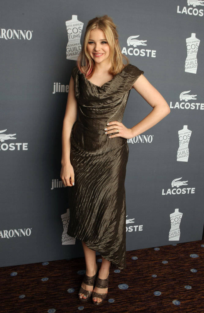 Chloë Moretz complemented her bronzed Vivienne Westwood frock with a pair of Jimmy Choo pumps in a moody snakeskin finish.