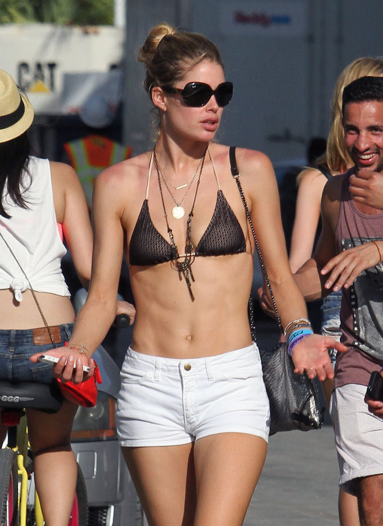 Doutzen Kroes in a brown bikini and white denim shorts in Miami.
