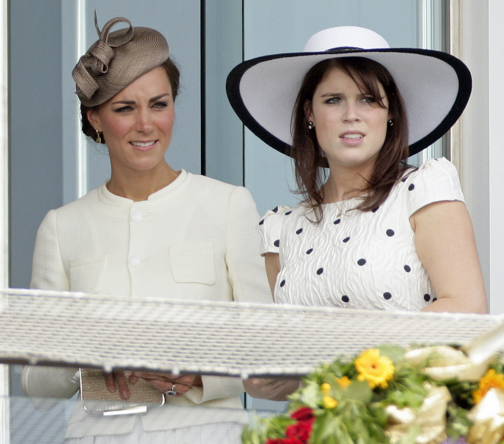 Eugenie and her new cousin in law Kate watch the a horse race from the royal box last June.
