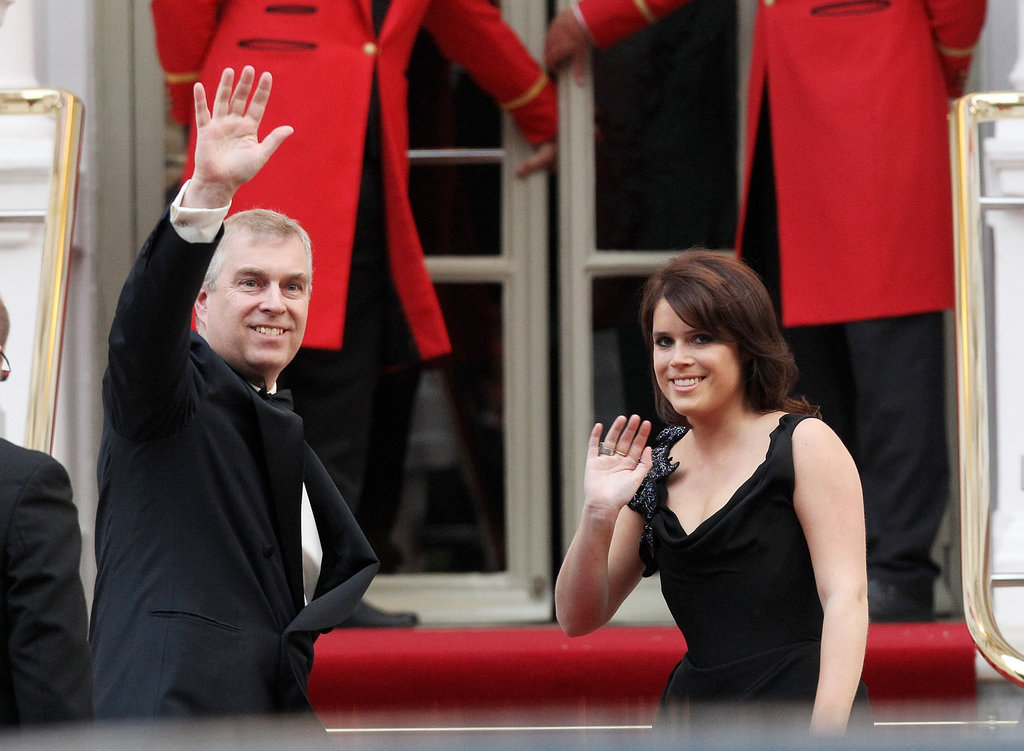 With her father Prince Andrew, Princess Eugenie makes her way into a party before Prince William and Kate Middleton's wedding.
