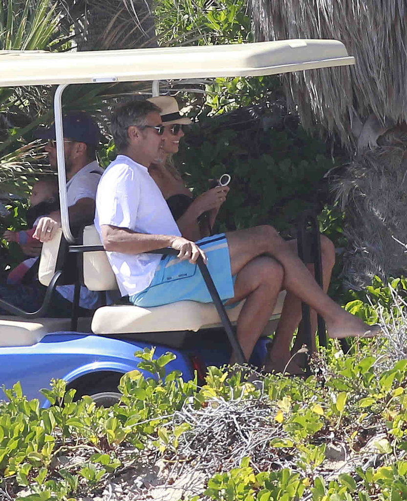 Stacy Keibler in a bikini with George Clooney.