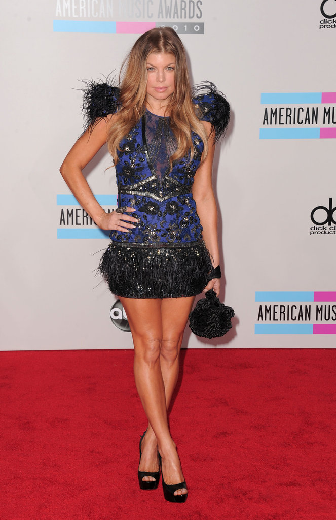 Feathers and sequins were the main theme of Fergie's 2010 American Music Awards look — the songstress sported a party-ready minidress by Falguni and Shane Peacock Couture with black peep-toe heels and a matching clutch.
