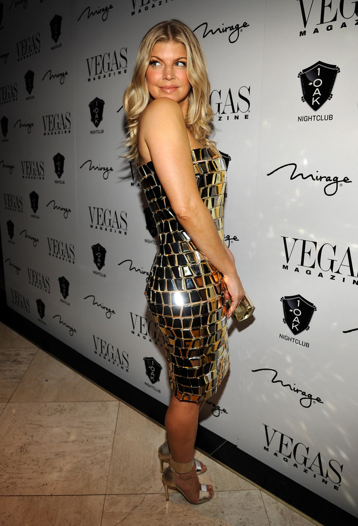 Fergie quite literally shined on the red carpet while hosting a 2011 New Year's Eve bash in Las Vegas — she wore a gold Nicolas Jebran strapless dress covered in tiny mirrors, making for one very disco-chic ensemble.
