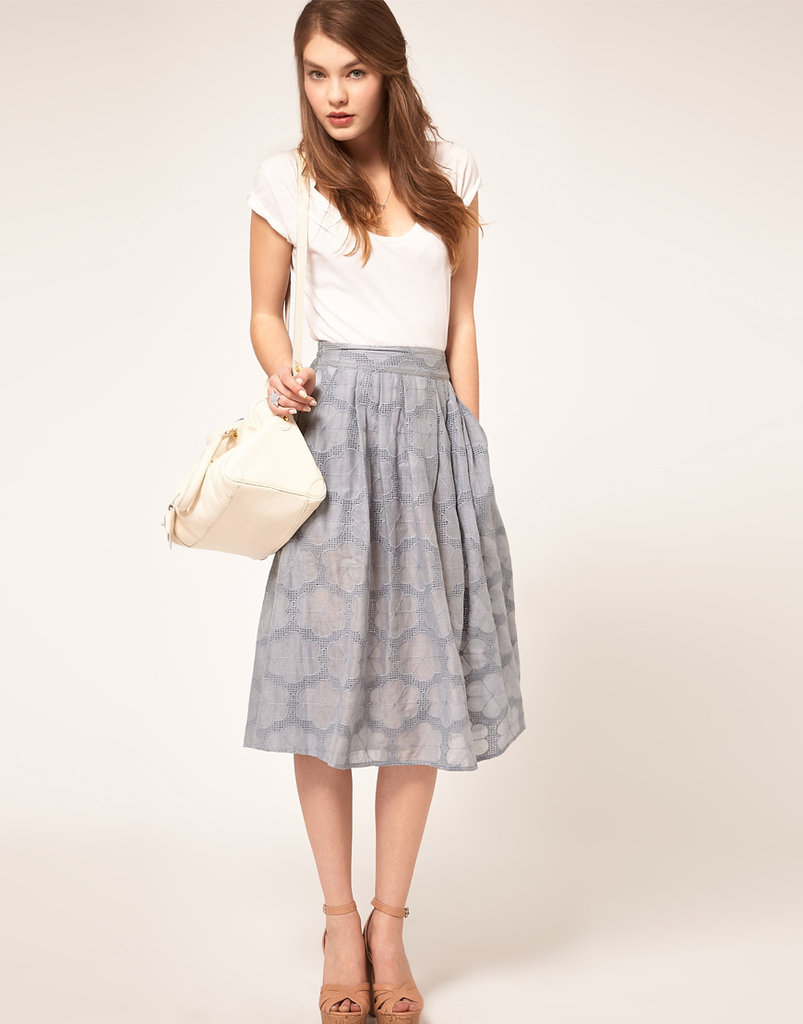 We can think of few things easier to throw on for a work day than a pretty circle skirt like this.  Asos Lady Circle Skirt in Floral Broderie ($81)