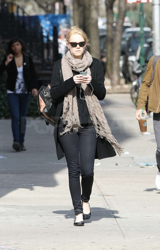 Emma Stone was bundled up in a scarf as she took a walk in NYC.